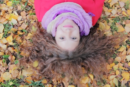 Image of beautiful young woman with autumn leaves Stock Photo - 17456626