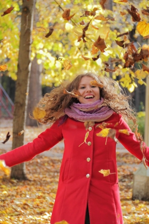 Image of beautiful young woman with autumn leaves Stock Photo - 17456631