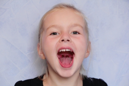 mouth  open: Portrait of girl with smile and open mouth Stock Photo