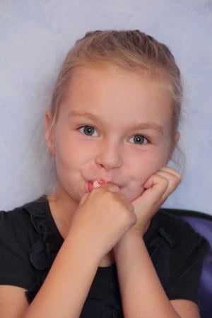 sweetmeat: Portrait of beautiful small girl eating sweetmeat