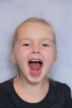 Portrait of girl with smile and open mouth Stock Photo