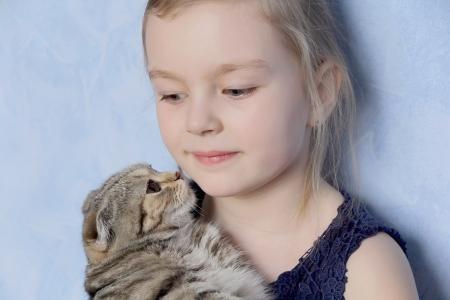 Portrait of beautiful girl with grey kitty Stock Photo