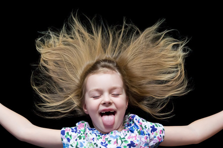 Girl makes faces imitate witch and put out tongue photo