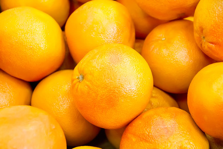Photo of background with orange ripe grapefruit