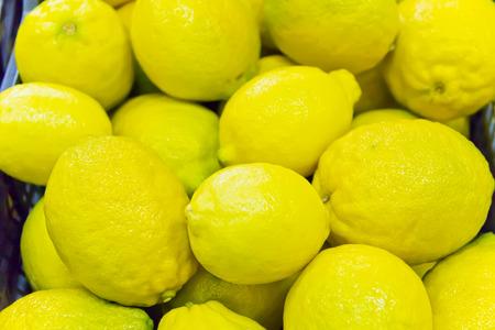 Photo of background with yellow ripe lemon