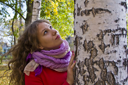 Photo of beautiful young woman in the autumn photo
