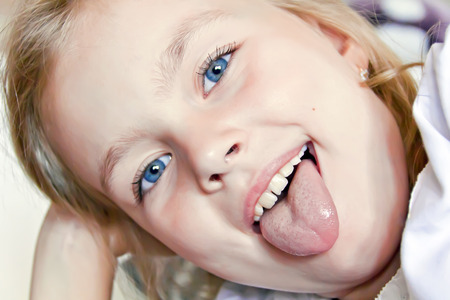 Portrait of cute girl with put out tongue