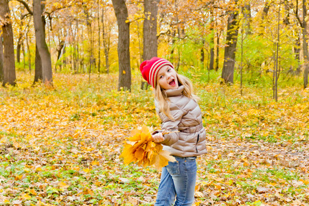 Photo of cute dancing girl in autumn Stock Photo