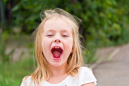 Photo of blond preschooler with open mouth Banco de Imagens