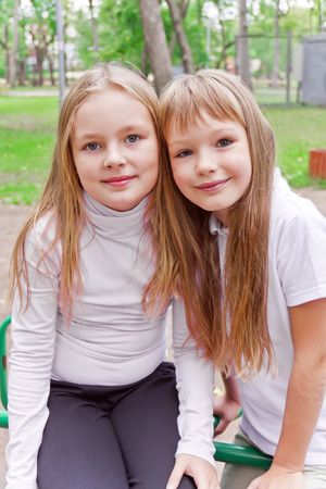 Photo of two cute girls with long hairs Stock Photo