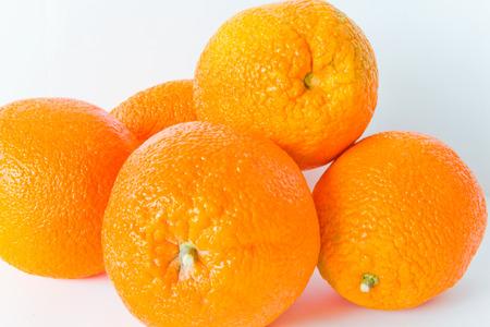 appetizing: Photo of appetizing ripe oranges on white background