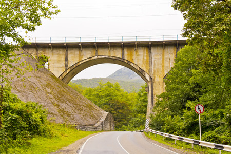Photo of landscape with bridge and road
