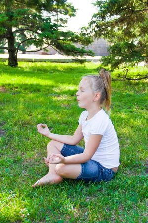 Photo of cute girl in lotus pose