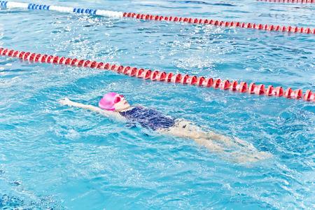 Photo of cute girl in swimming pool