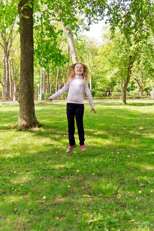 Photo of cute jumping girl in summer