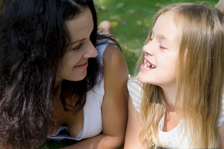 each: Mother and daughter looking to each others Stock Photo