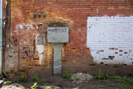 gritty: Photo of old red brick gritty wall