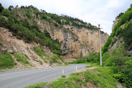 dombai: Landscape of road in Caucasus green mountains Stock Photo
