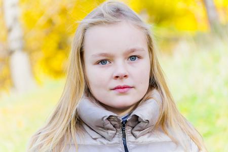 blond girl: Autumn portrait of blond girl in sunlight