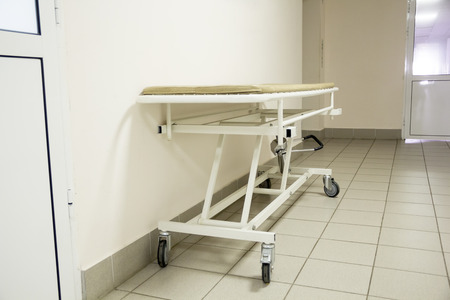 surgery stretcher: Photo of empty stretcher in hospital corridor Stock Photo