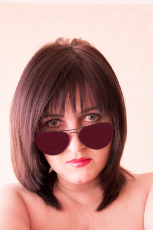 Photo of brunette woman face in sunglass