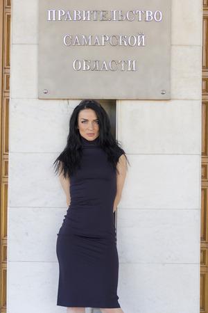 graffito: Photo of European brunette on background wall under inscription