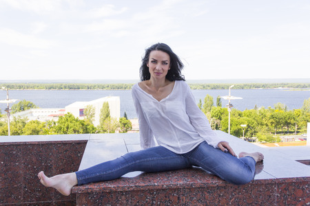 Photo of young woman in pose twine