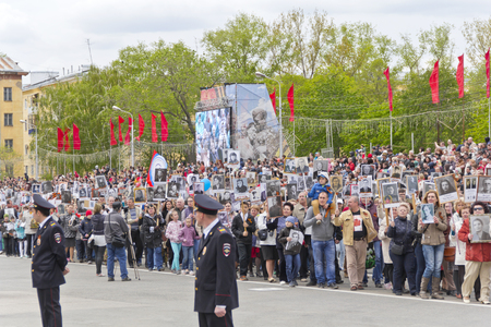 social actions: Samara, Russia - May 9, 2015: Procession of the people in Immortal Regiment on annual Victory Day