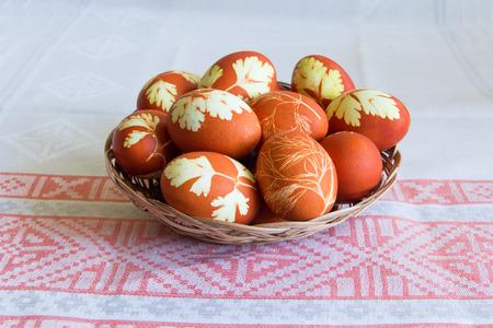 Photo of Easter eggs in wickerwork plate