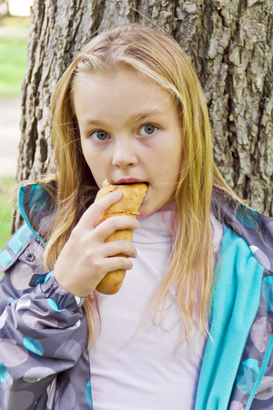 Photo of eating cute girl with blond hair Stock Photo