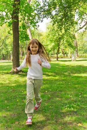 Photo of cute running girl in summer Stock Photo