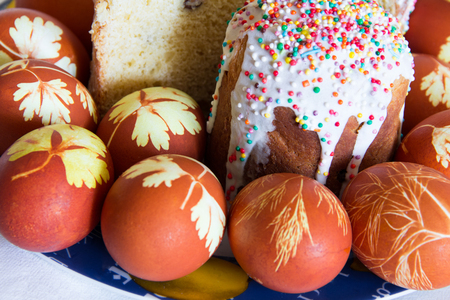 Photo of background with Easter eggs and Kulich Stock Photo