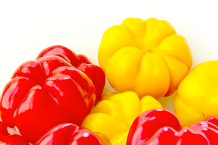 Photo of red and yellow raw pepper on white background Stock Photo