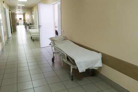 surgery stretcher: Photo of empty stretcher in hospital corridor Stock Photo