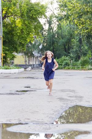 disheveled: Cute running European girl with disheveled hair