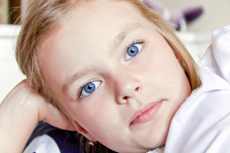 Photo of cute girl with big blue eyes