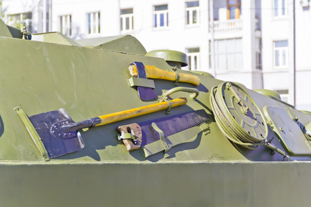bailer: Military machine at the exhibition under open sky with shovel, ax and saw Stock Photo