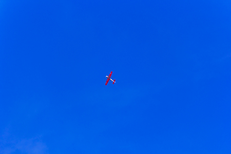 Photo of flying military airplane in blue sky
