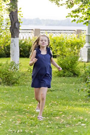 Cute running European girl with disheveled hair in summer