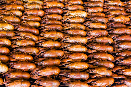 Photo of background with red boiled crawfishes Stock Photo