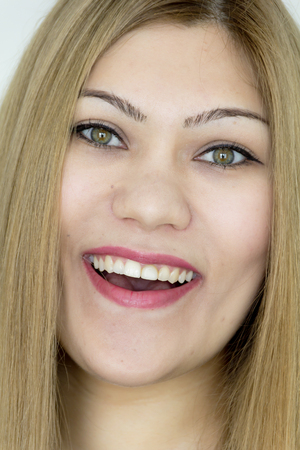 Attractive smiling young girl with straight hair and green eyes