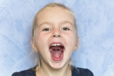 Cute cry girl with blond hair with open mouth