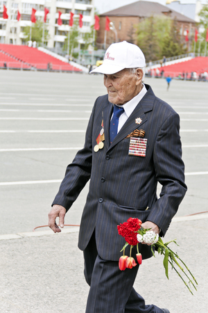 SAMARA, RUSSIA - MAY 9, 2017: Russian veteran on celebration at the parade annual Victory Day, May, 9, 2017 in Samara, Russia