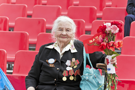 SAMARA, RUSSIA - MAY 9, 2017: Woman is Russian veteran on celebration at the parade annual Victory Day, May, 9, 2017 in Samara, Russia