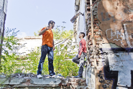 Father and teenager son are playing in ruins house Standard-Bild