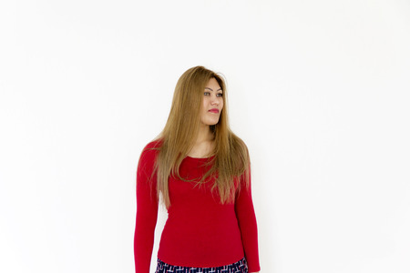 Attractive young girl with long brown healthy straight hair in red