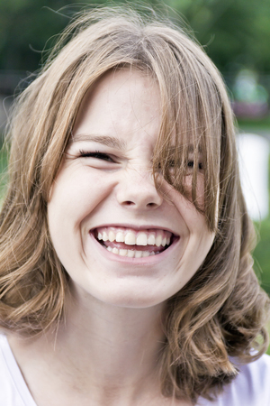 Portrait of laugh blond girl fourteen years old Banco de Imagens