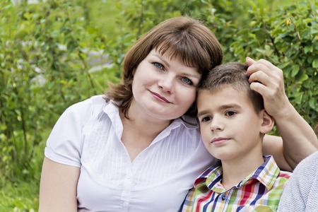 Happiest mother and son eleven years old in summer time