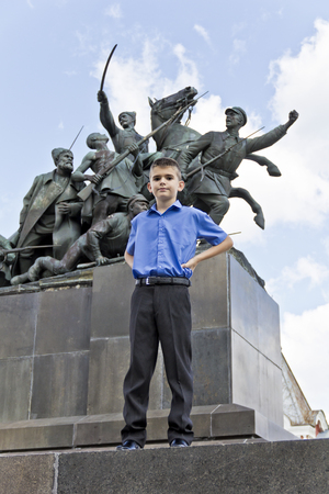 Cute brunette boy eleven years old in monument background