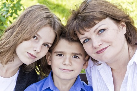 Portrait of happiest mother with daughter and son in summer time Stock Photo